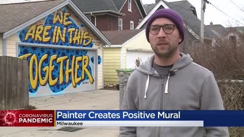 Homeowner paints inspirational mural on garage to lift others...